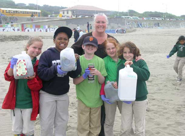 Kids with beach trash they've cleaned up